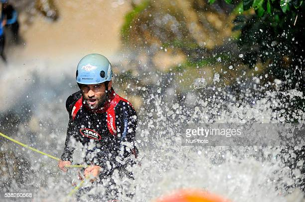 Canyoning sports Enthusiast cheers on waterfall during 2nd National Canyoning Randezvous oraganized by Nepal Canyoning Association at Chahare Jharana...