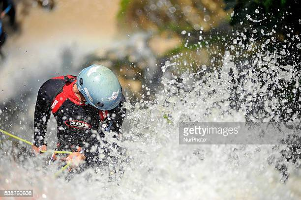 Canyoning sports Enthusiast playing on waterfall during 2nd National Canyoning Randezvous oraganized by Nepal Canyoning Association at Chahare...
