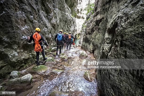 Canyoning team moving through the canyon