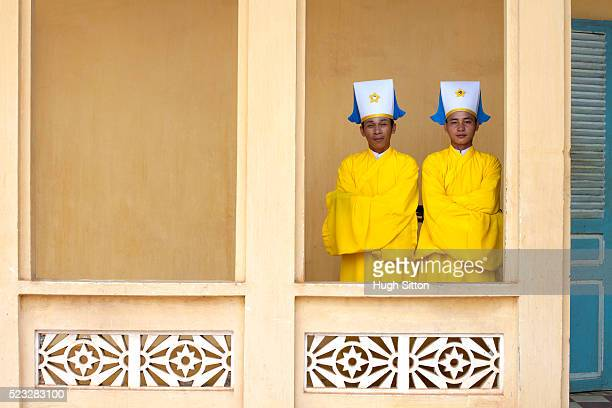 cao dai priests, cao dai temple. near ho chi minh. vietnam - hugh sitton stock pictures, royalty-free photos & images