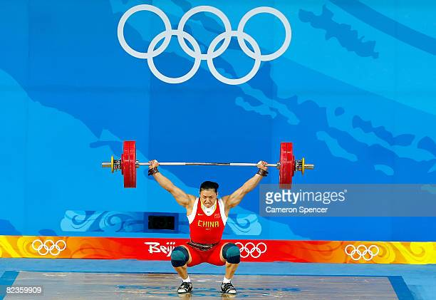 Cao Lei of China attempts a new Olympic record lift of 128k in the women's 75kg weightlifting event at the Beijing University of Aeronautics...