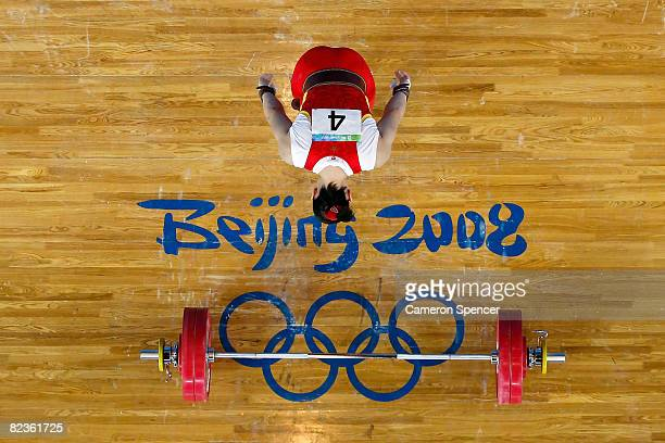 Cao Lei of China bows she completes a successful lift in the women's 75kg weightlifting event at the Beijing University of Aeronautics Astronautics...