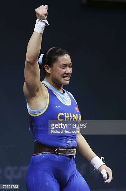 Cao Lei of China celebrates victory in the Women's 75kg Weightlifting Group A Final during the 15th Asian Games Doha 2006 at the AlDana Banquet Hall...