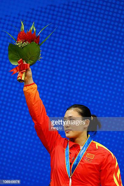 Cao Lei of China celebrates winning the silver medal in the weightlifting Women's 75 kg Group A during day six of the 16th Asian Games Guangzhou 2010...