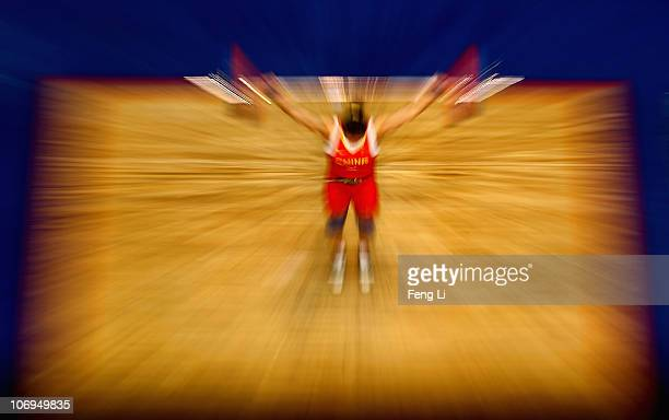 Cao Lei of China competes in the weightlifting Women's 75 kg Group A during day six of the 16th Asian Games Guangzhou 2010 at Dongguan Gymnasium on...