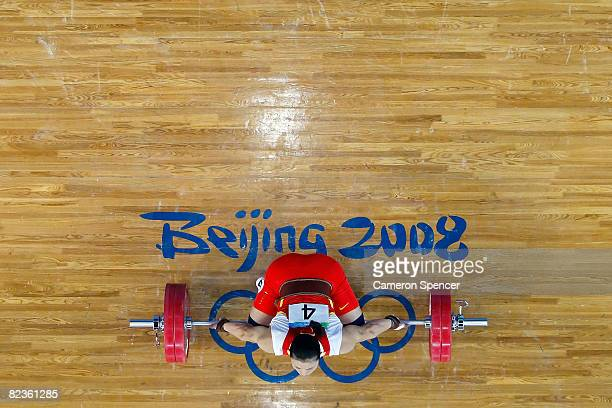 Cao Lei of China competes in the women's 75kg weightlifting event at the Beijing University of Aeronautics Astronautics Gymnasium on Day 7 of the...