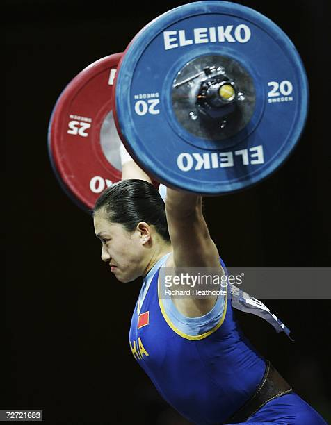 Cao Lei of China competes in the Women's 75kg Weightlifting Group A Final during the 15th Asian Games Doha 2006 at the AlDana Banquet Hall on...