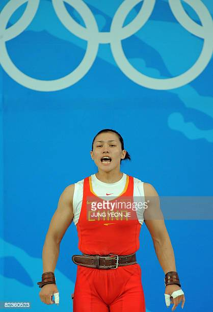 Cao Lei of China prepares to lift in the women's 75 kg weightlifting event during the 2008 Beijing Olympic Games at the Beijing University of...