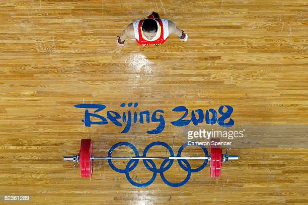 Cao Lei of China prepares to lift in the women's 75kg weightlifting event at the Beijing University of Aeronautics Astronautics Gymnasium on Day 7 of...