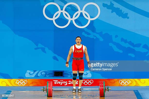 Cao Lei of China reacts after she completes a successful lift in the women's 75kg weightlifting event at the Beijing University of Aeronautics...