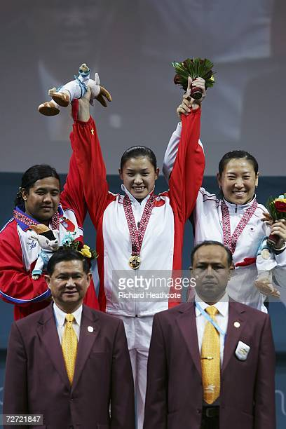 Cao Lei of China receives gold medal Mya Sanda Oo of Myanmar receives her silver medal and Kim Soon Hee of the Republic of Korea receives her bronze...