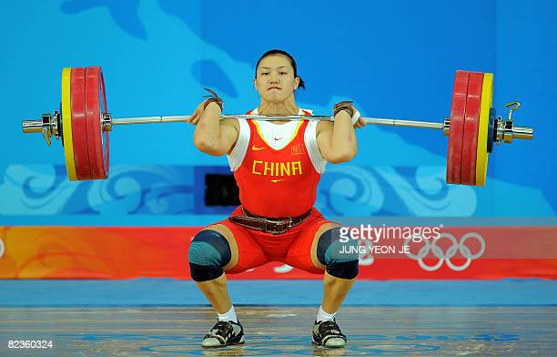 Cao Lei of China sets a new olympic record in the clean and jerk lifting 154 kg in the women's 75 kg weightlifting event during the 2008 Beijing...