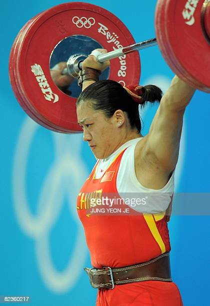 Cao Lei of China sets a new Olympic record in the snatch lifting 128 kg in the women's 75 kg weightlifting event during the 2008 Beijing Olympic...