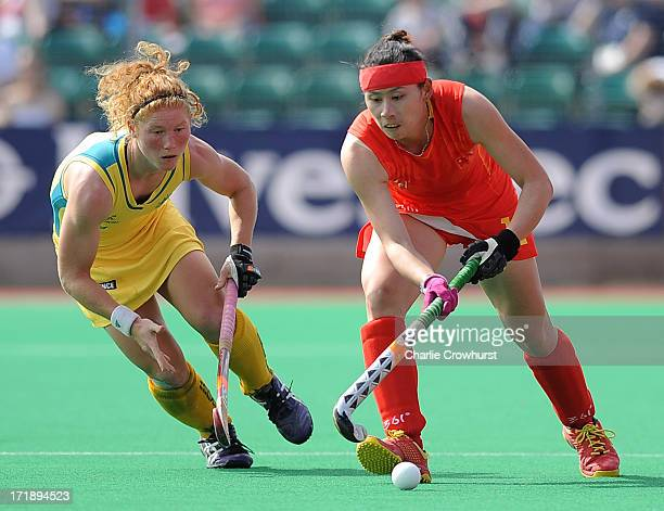 Cao Yannan of China attacks past Georgia Nanscawen of Australia during the Investec Hockey World League Semi Finals match between China and Australia...