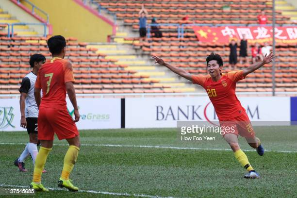Cao Yongjing of China celebrates after scoring against Laos during the AFC U23 Championship qualifier between China and Laos at Shah Alam Stadium on...