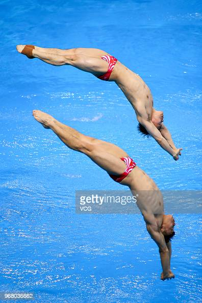 Cao Yuan of China and Xie Siyi of China compete in the Men ...