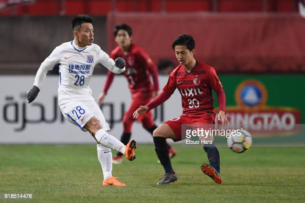 Cao Yunding of Shanghai Shenhua and Hiroki Abe of Kashima Antlers compete for the ball during the AFC Champions League Group H match between Kashima...