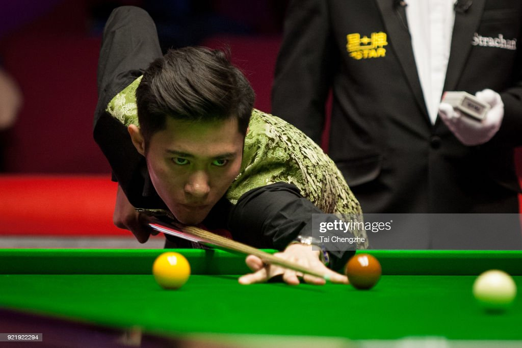 Cao Yupeng of China plays a shot during his first round match against Anthony McGill of Scotland on day two of 2018 Ladbrokes World Grand Prix at Guild Hall on February 20, 2018 in Preston, England.