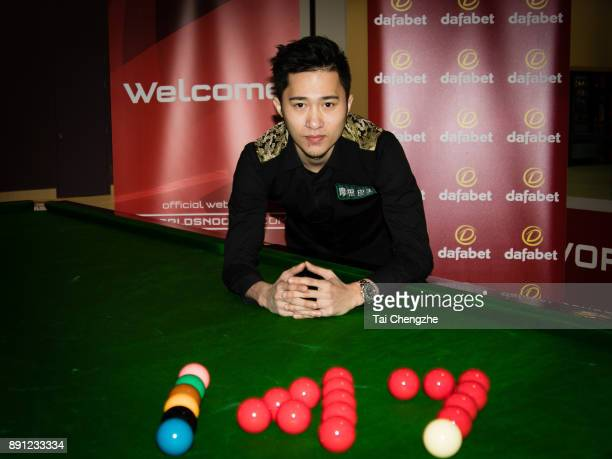 Cao Yupeng of China poses for a photo after he made a maximum break in his first round match against Andrew Higginson of England during the 2017...