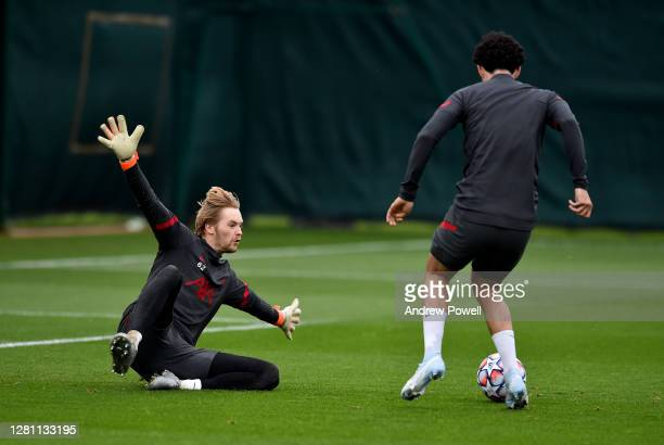Caoimhin Kelleher and Curtis Jones of Liverpool during a training session at Melwood Training Ground on October 19 2020 in Liverpool England