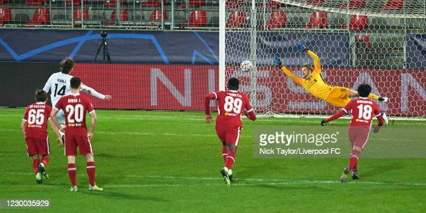 Caoimhin Kelleher of Liverpool can't stop the penalty kick of Alexander Scholz of Midtjylland during the UEFA Champions League Group D stage match...