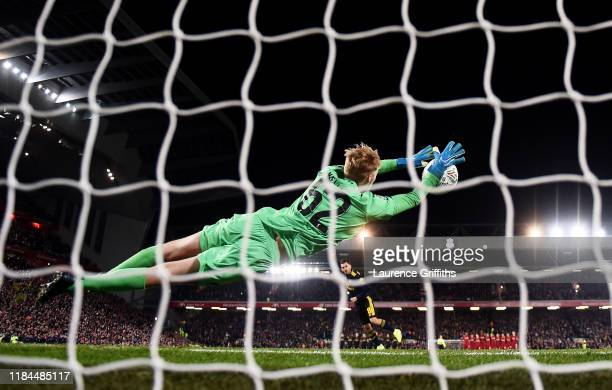 Caoimhin Kelleher of Liverpool saves Dani Ceballos of Arsenal penalty during the penalty shoot out during the Carabao Cup Round of 16 match between...