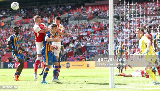 Caolan Lavery of Rotherham Shrewsbury captain Mat Sadler and Rotherham captain Richard Wood go up for a header in the box during the Sky Bet League...
