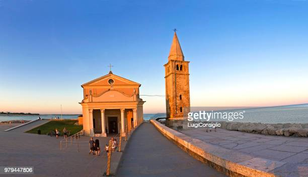 caorle (ve), italy; madona church of the angel of caorle located on the coast - madona stock photos and pictures