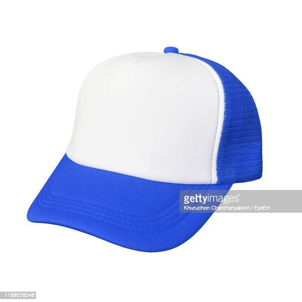 cap against white background - cap stock pictures, royalty-free photos & images