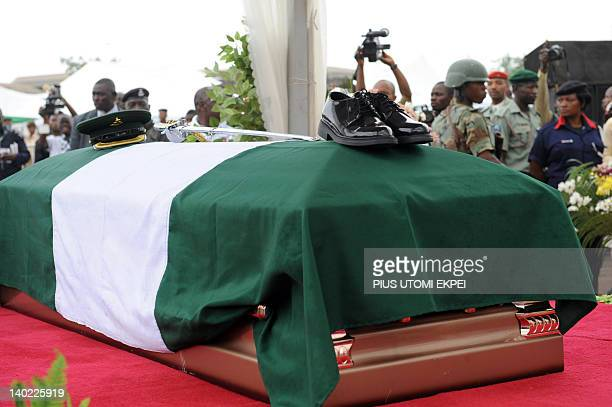 A cap and boots have been placed atop the bronze casket containing the body of Nigeria's secessionist leader Odumegwu Ojukwu wrapped in the...