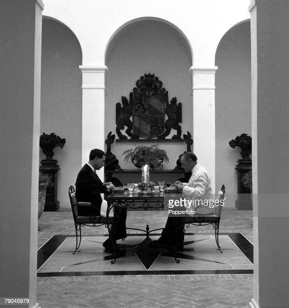 Cap Ferrat France English author Somerset Maugham is pictured with his secretarycompanion as they eat dinner at the Villa Mauresque