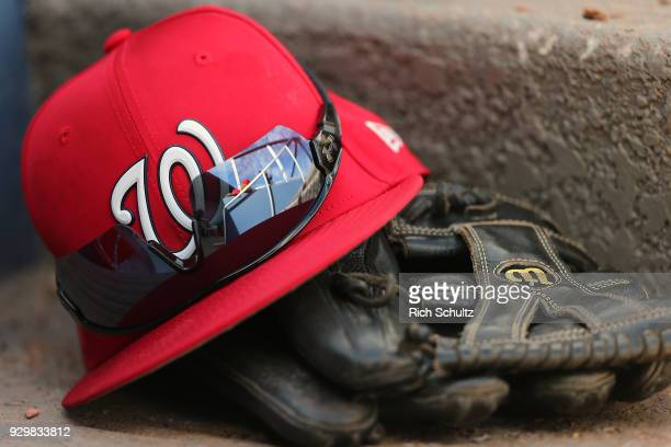 A cap glove and sunglasses of a Washington Nationals player sits on a dugou stept during a spring training game against the New York Mets at FITTEAM...