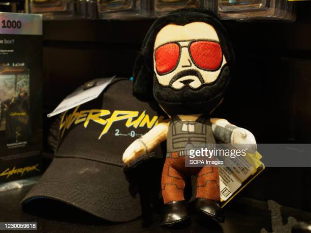 Cap with game logo and Johnny Silverhand seen on display. Cyberpunk 2077 is a 2020 action role-playing video game on sale worldwide. In Russia it has...