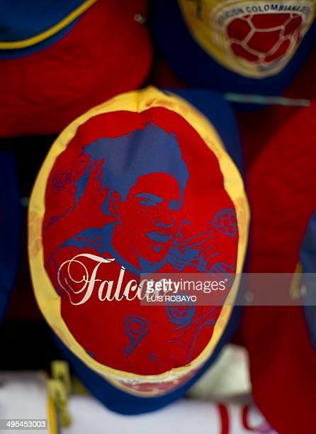 A cap with the image of Colombia's national football team forward Radamel Falcao Garcia for sale at a street stall as souvenir on June 3 in Cali...