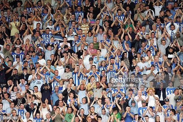 A capacity crowd applauds their players' efforts during the Barclays Premiership match between Wigan Athletic and Chelsea on August 14 2005 in Wigan...