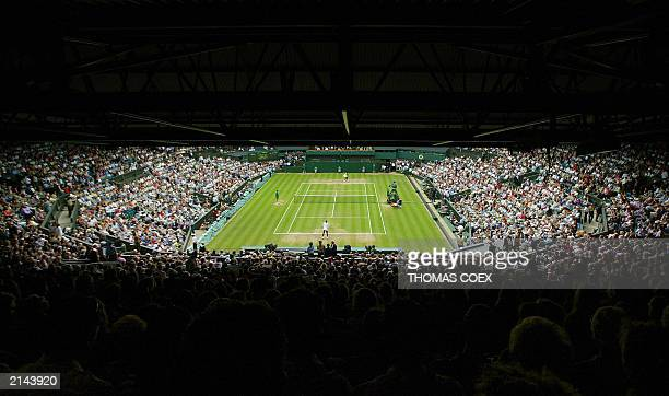 Capacity crowd on Center Court watches the Ladies' Final match between Venus Williams of the US and Serena Williams of the US at the Wimbledon Tennis...