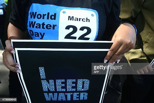 A capaigner holds a placard during a World Water Day rally in Malang East Java on March 22 2014 March 22 marks the World Water Day which is an...