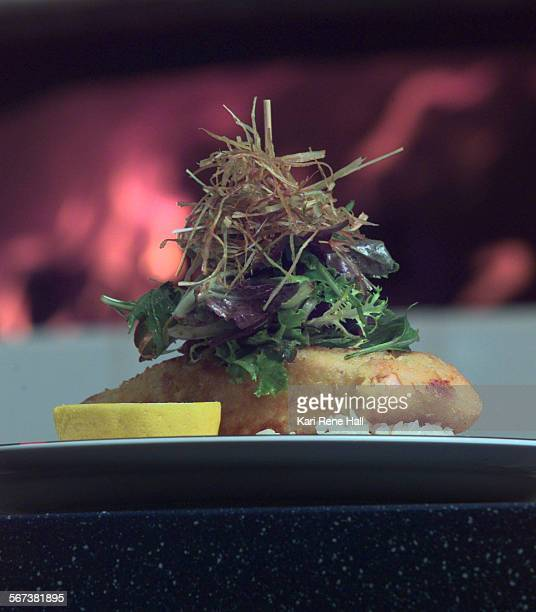 CAPCHgrillsalmon2KRH7/10/97Flames in a wood fire form a backdrop for Baked Panko Salmon an entree on the menu at Disney's PCH California Grill at the...
