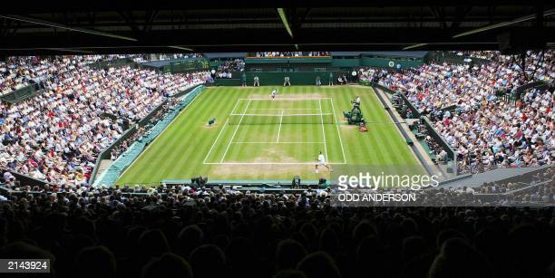 A capcity crowd watches Roger Fedrer of Switzerland and Mark Philippoussis of Australia during their Men's Final match on Centre Court at the...