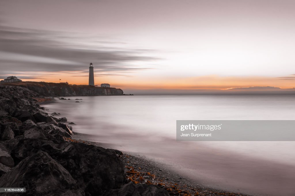 Cap-des-Rosiers lighthouse sunrise desaturated long exposure DRI : Stock Photo