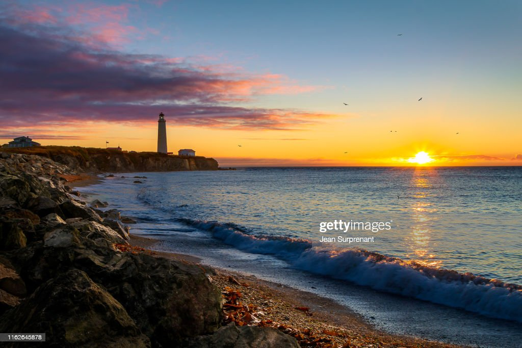 Cap-des-Rosiers lighthouse sunrise DRI : Stock Photo