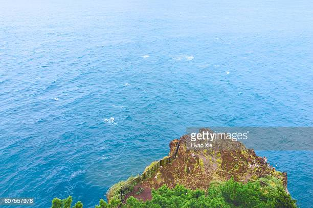 cape and sea - liyao xie stock pictures, royalty-free photos & images