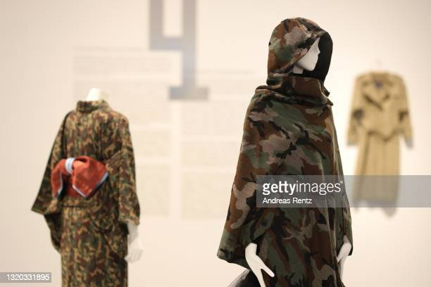 Cape and sweater by Junya Watanabe of Comme des Garcon is seen during the exhibition Dress Code: Are You Playing Fashion? - A collection of The Kyoto...
