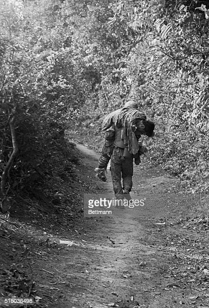Cape Batamgan South Vietnam A Long Walk It's a long walk when a wounded buddy has to be carried to safety and there are no stretchers around Here a...