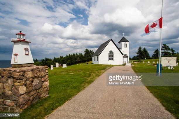 cape breton island, nova scotia, canada - flag of nova scotia stock pictures, royalty-free photos & images