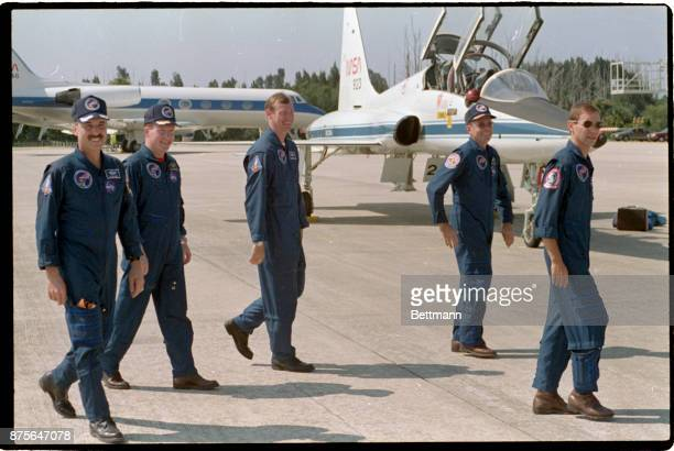 8/5/1989 Cape Canaveral FL Crewmembers for the space shuttle Columbia walk across the tarmac after they arrived at the Kennedy Space Center 8/5 The...