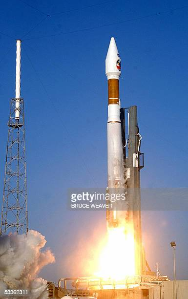 A Lockheed Martin Atlas 5 rocket lifts off 12 August from complex 41 at Cape Canaveral Florida carrying NASA's Mars Reconnaissance Orbiter into space...