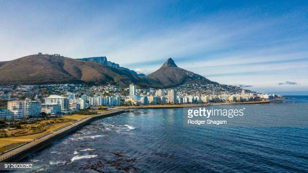 cape coastline with signal hill, lion's head and table mountain. - south africa stock pictures, royalty-free photos & images