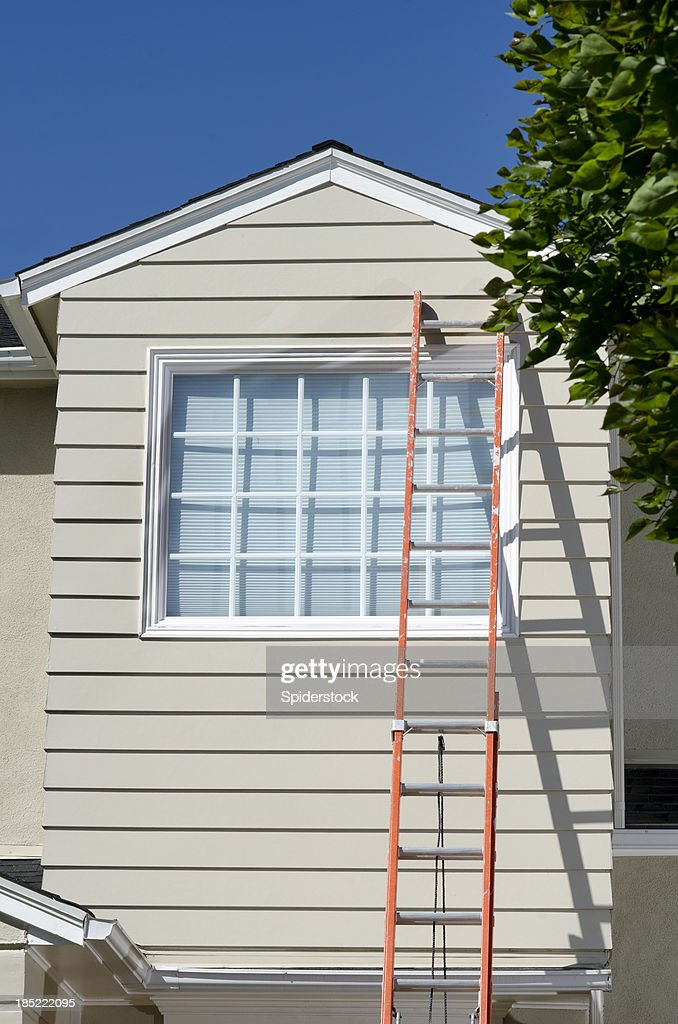 Cape Cod Style House With Ladder : Stock Photo