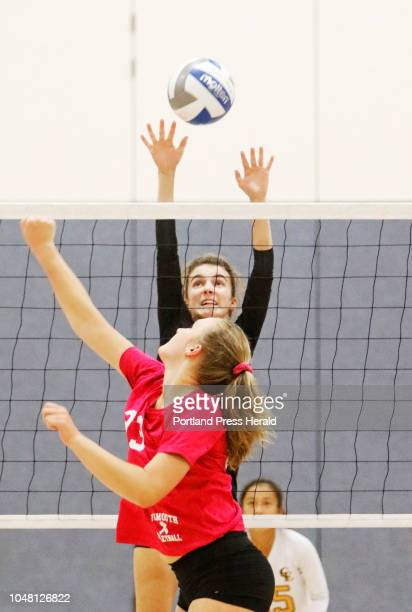Cape Elizabeth Brooke Harvey defends while Falmouth Annika Hester reacts at the net during volleyball at Falmouth
